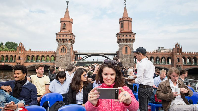 A Tech Open Air female participant, taking a selfie on a boat on the river Spree in Berlin on July 13th 2016.